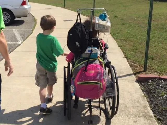 Siblings many times fall into the role of caregiver naturally overseeing safety and health needs of their family member during play and other activities.