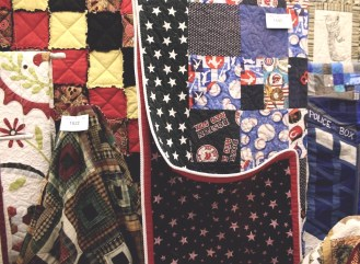 A baseball themed quilt complete with American flag style stars