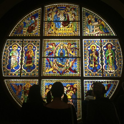 Admiring the captivating stained glass window