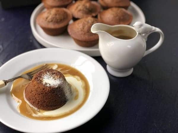sticky date on a plate with butterscotch sauce and cream