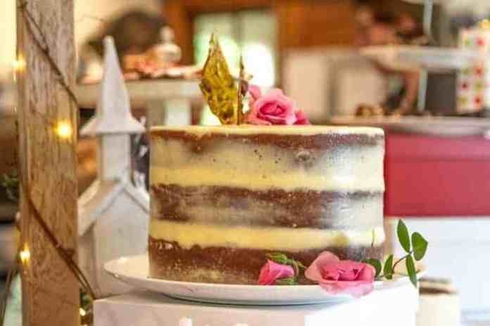 A vanilla and rose cake on display