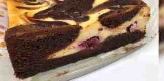 image of a sliced raspberry swirl brownie showing the swirl