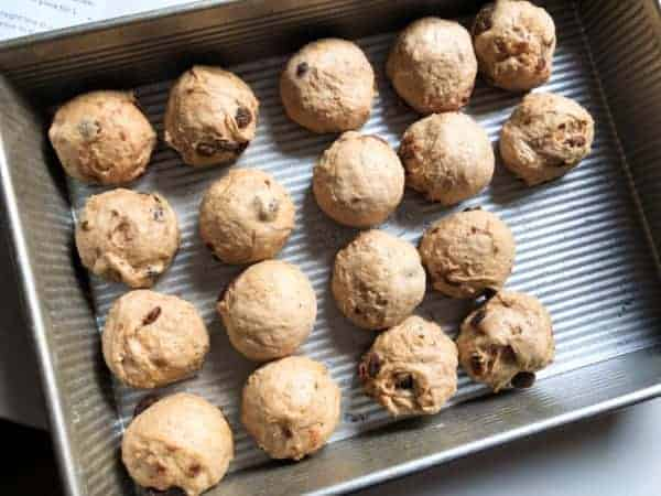 A tray of Hot Cross buns ready for proving