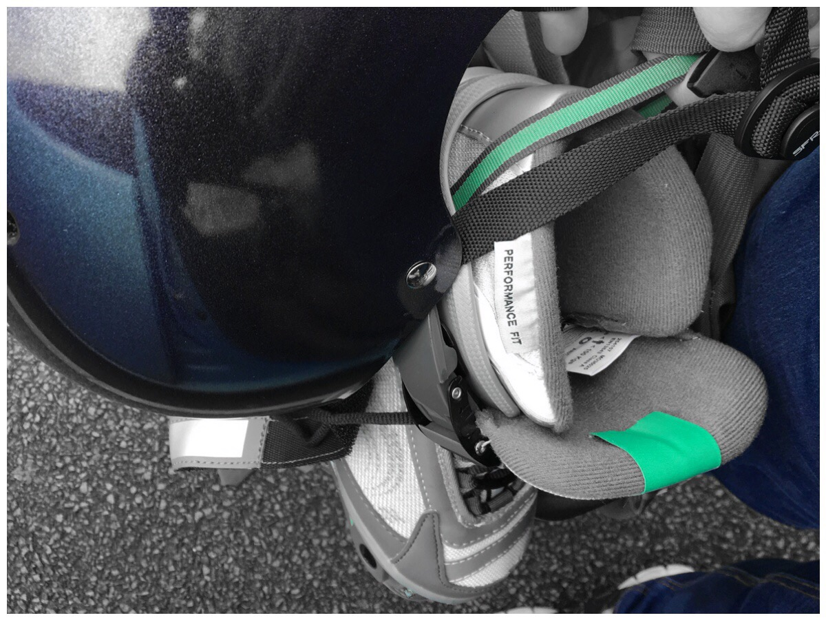 Closeup photo of a rollerblade and helmet being carried