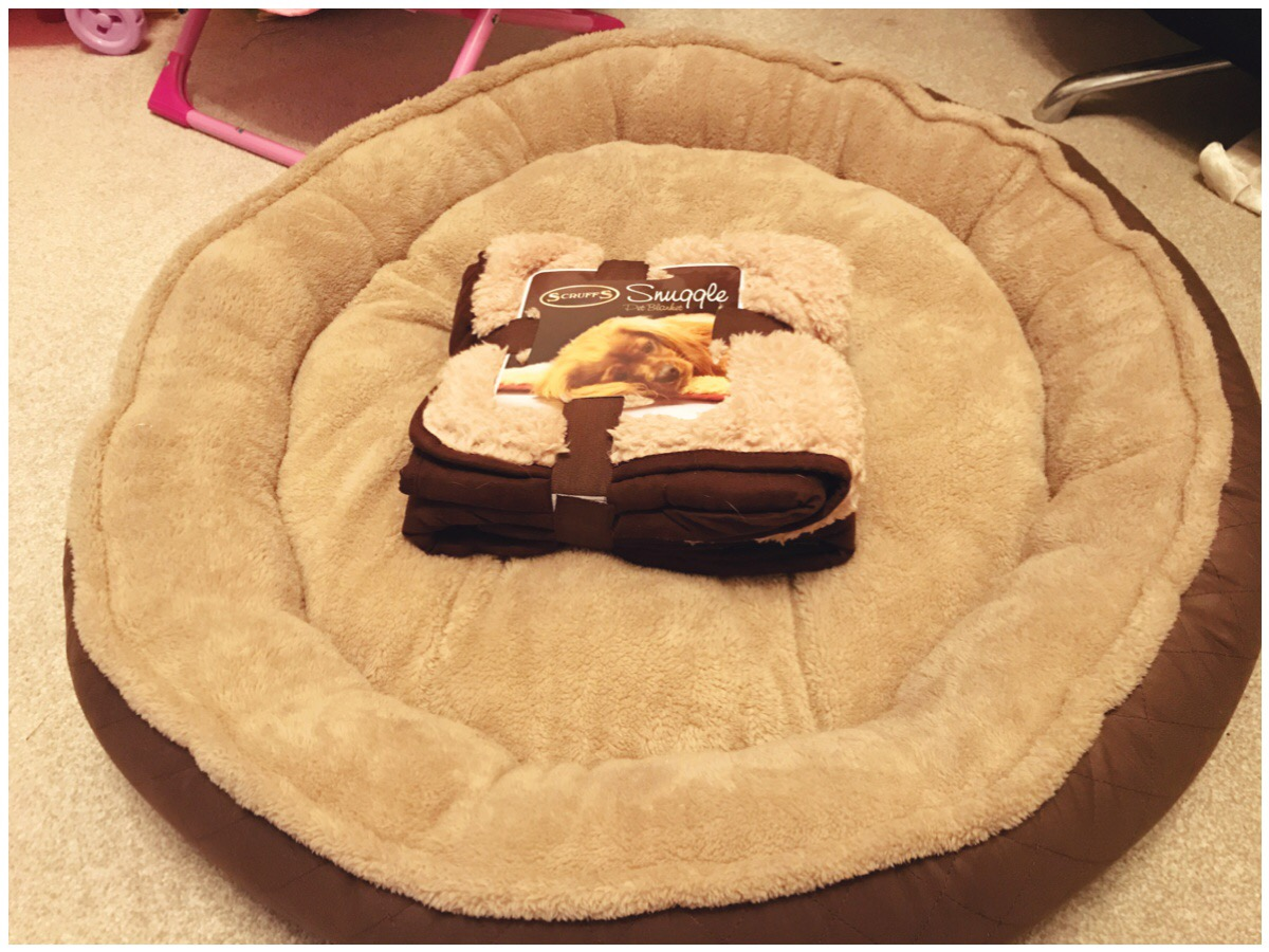 Two tone brown dog bed and fleecy blanket