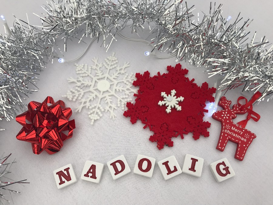 Nadolig Llawen - image with red bow, white snowflake, Rudolph and tinsel