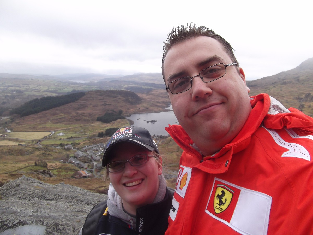 Selfie of me and the husband with the view of Tanygrisiau reservoir in the background and further afield the view towards Trawsfynydd
