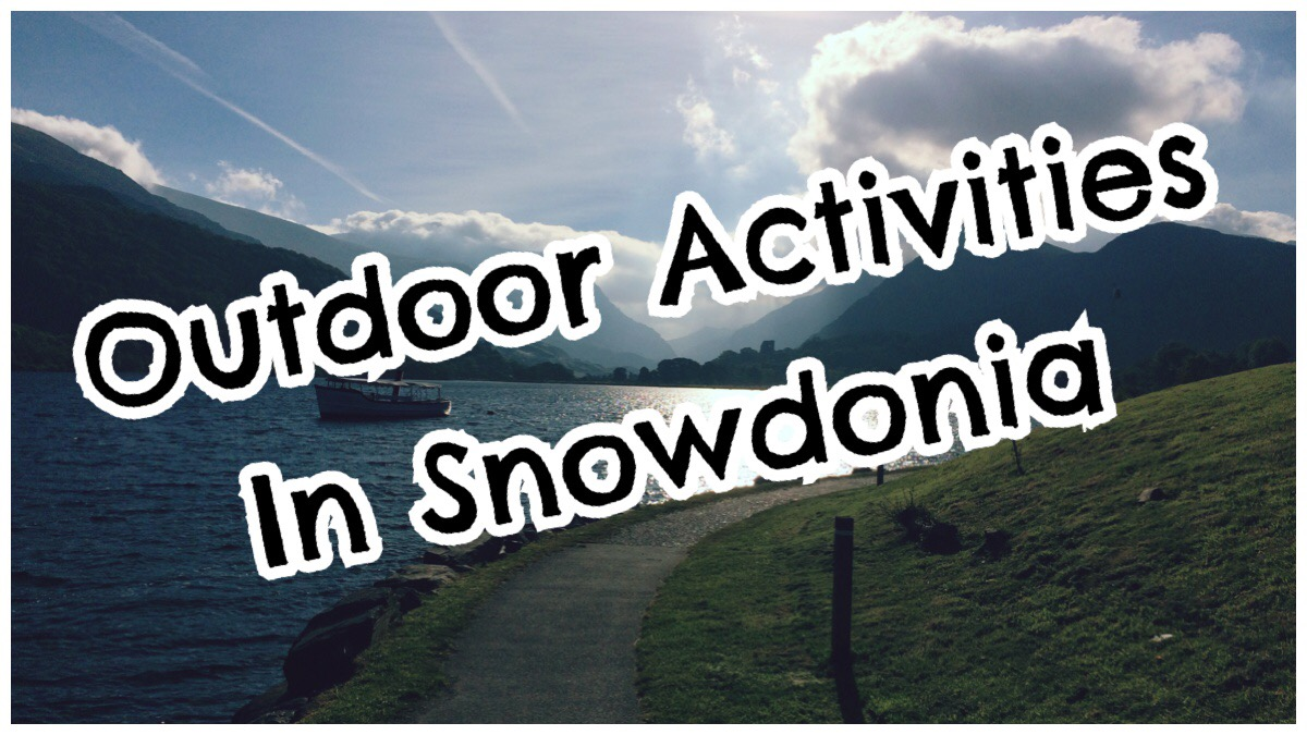 "The words ""outdoor activities in Snowdonia"" in big bold print over a photo of Llanberis lake on a sunny day"