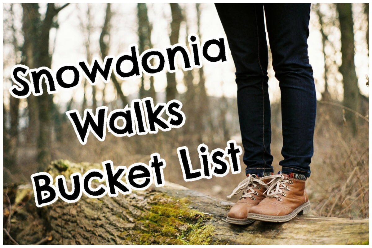 Snowdonia Walks Bucket List header image of a woman's legs wearing walking boots stood on a fallen tree