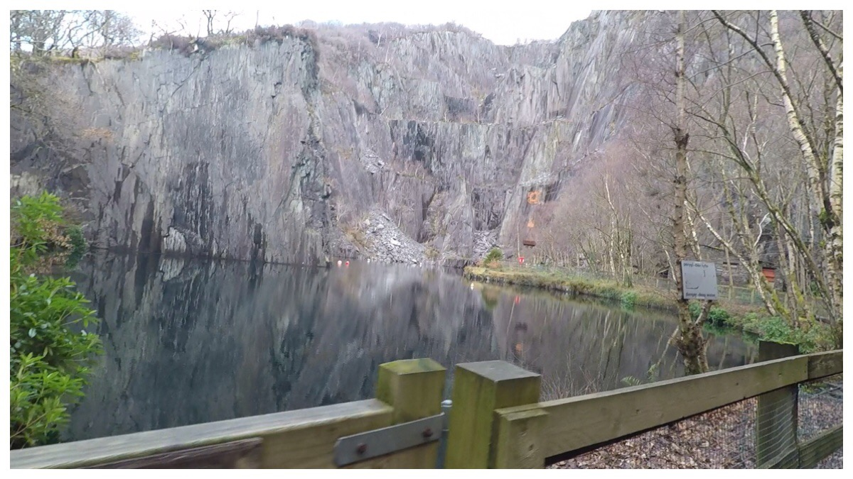 The lake and impressive slate edges at Vivian Quarry