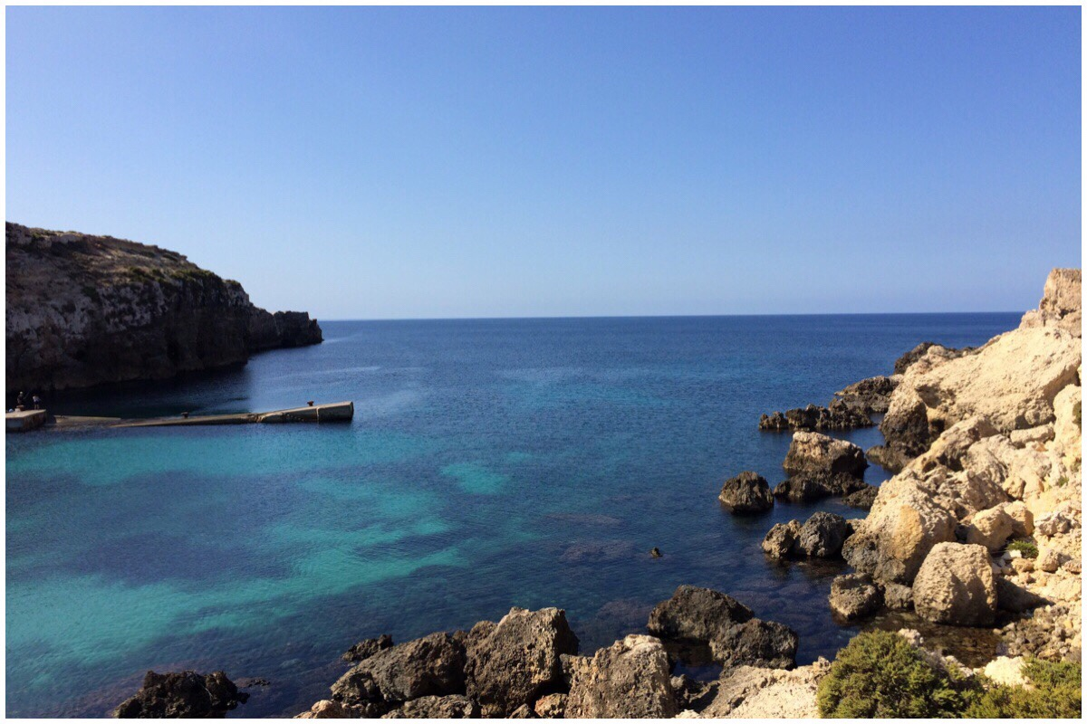 Anchor Bay - the view out to sea. Beautiful blue waters, jagged rocky cliffs and perfect blue sky
