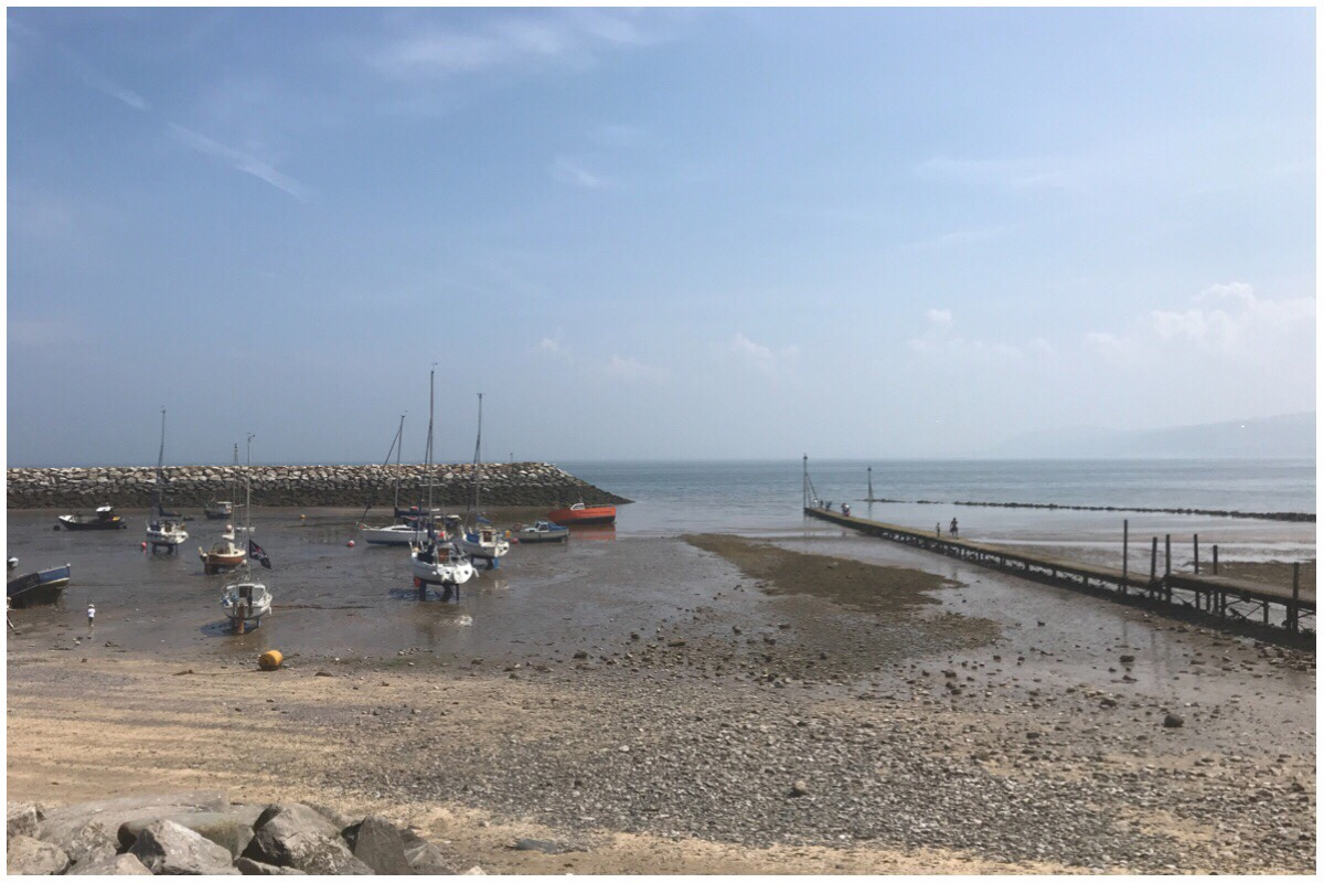 Rhos On Sea Pirate Weekend - the view of boats in the sand as the tide is out