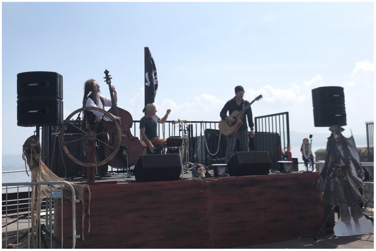 A band playing on the stage at the Rhos On Sea Pirates Weekend