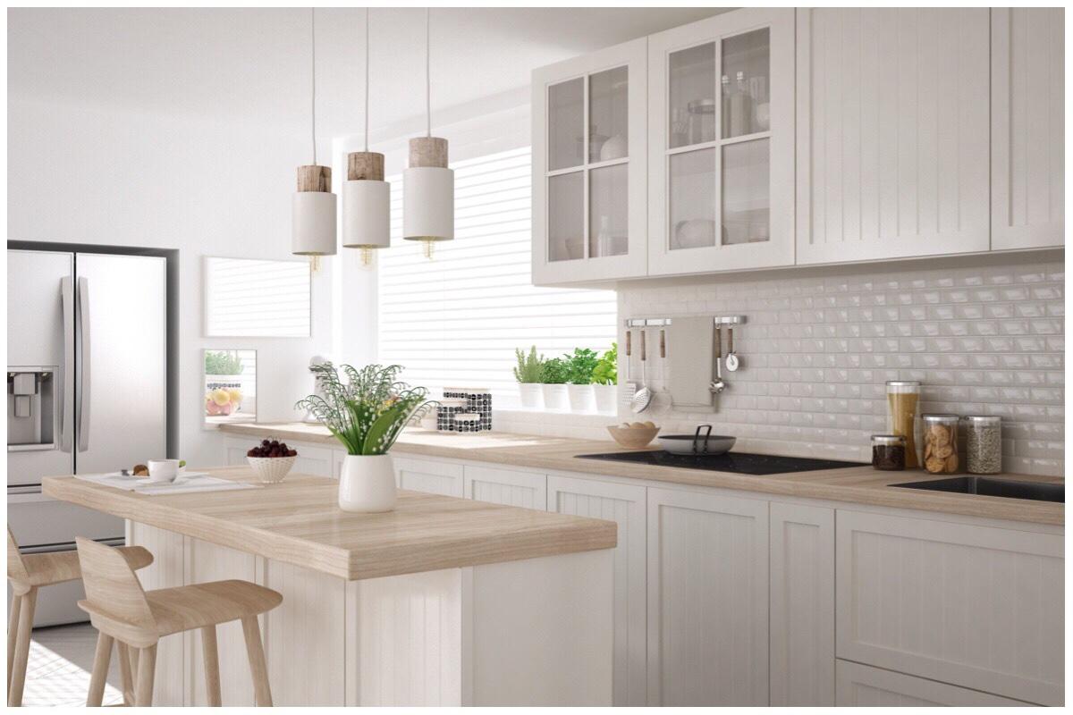 Cream coloured stylish kitchen with light brown worktops - my dream kitchen!
