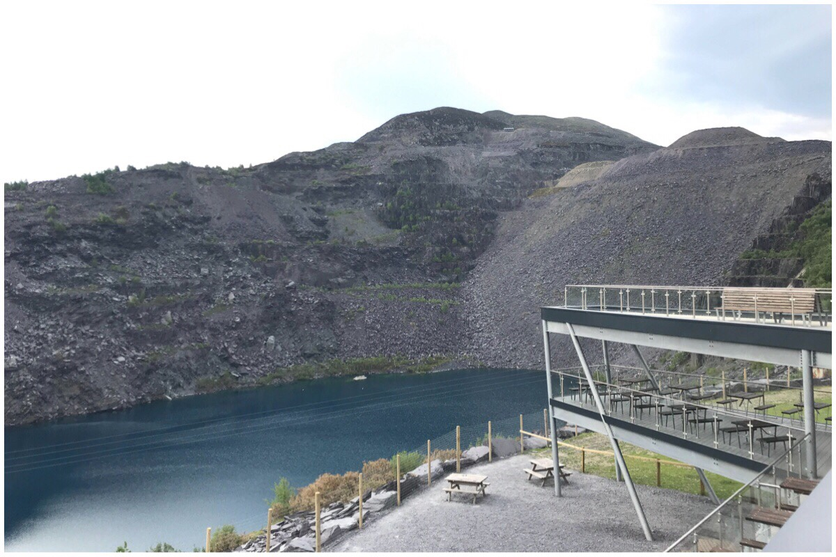The view at Zipworld Penrhyn Quarry. You can see the slate heaps behind the lake. In front is the mini zipwire