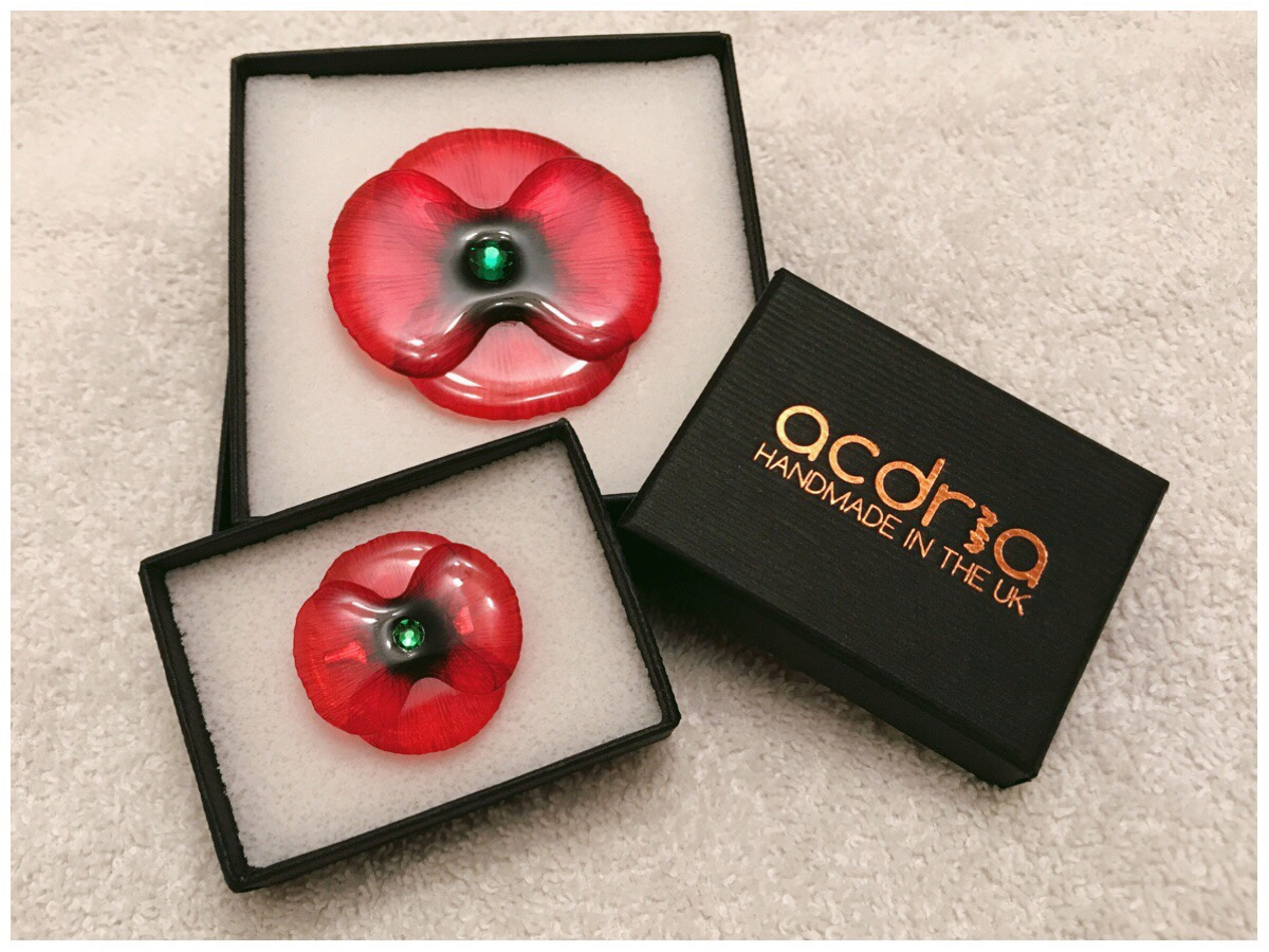 Pictured - the little and large poppy brooch in their gift boxes. Also pictured is the Acdria branded gift box
