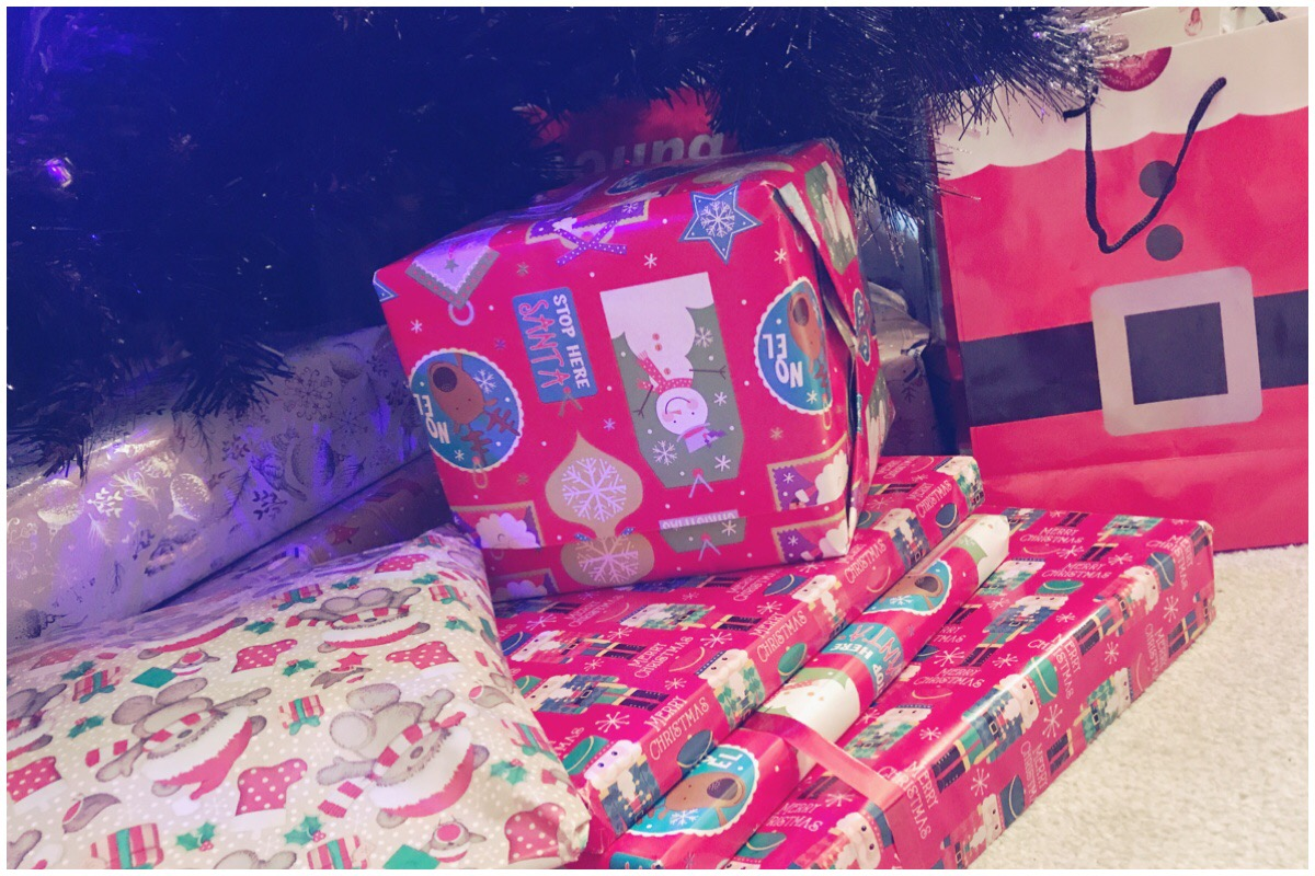 A few Christmas gifts under the tree