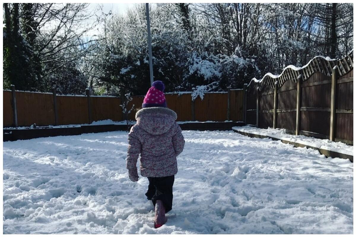 My eldest in our snowy garden
