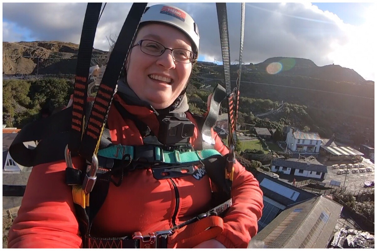 A photo of me on Titan's Charlie line. In the background is the building of the old Llechwedd slate quarry