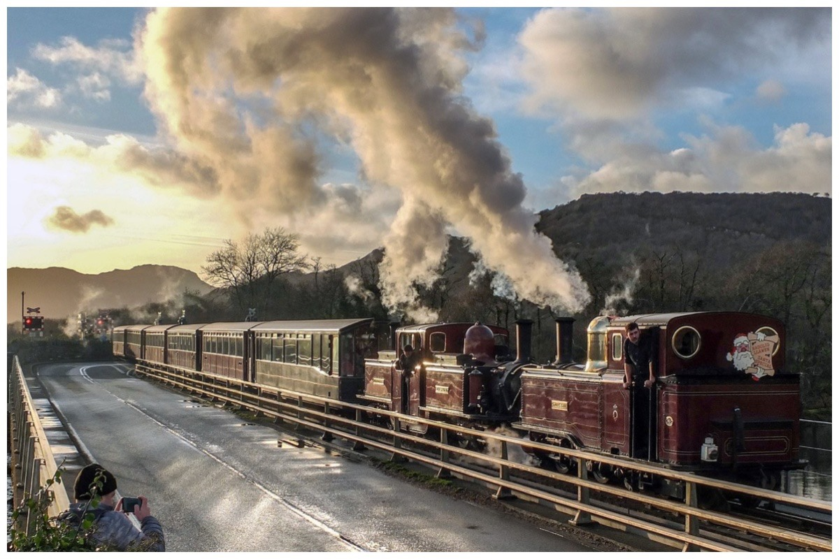 Ffestiniog Railway's Santa Train crossing Pont Croesor in the setting sun
