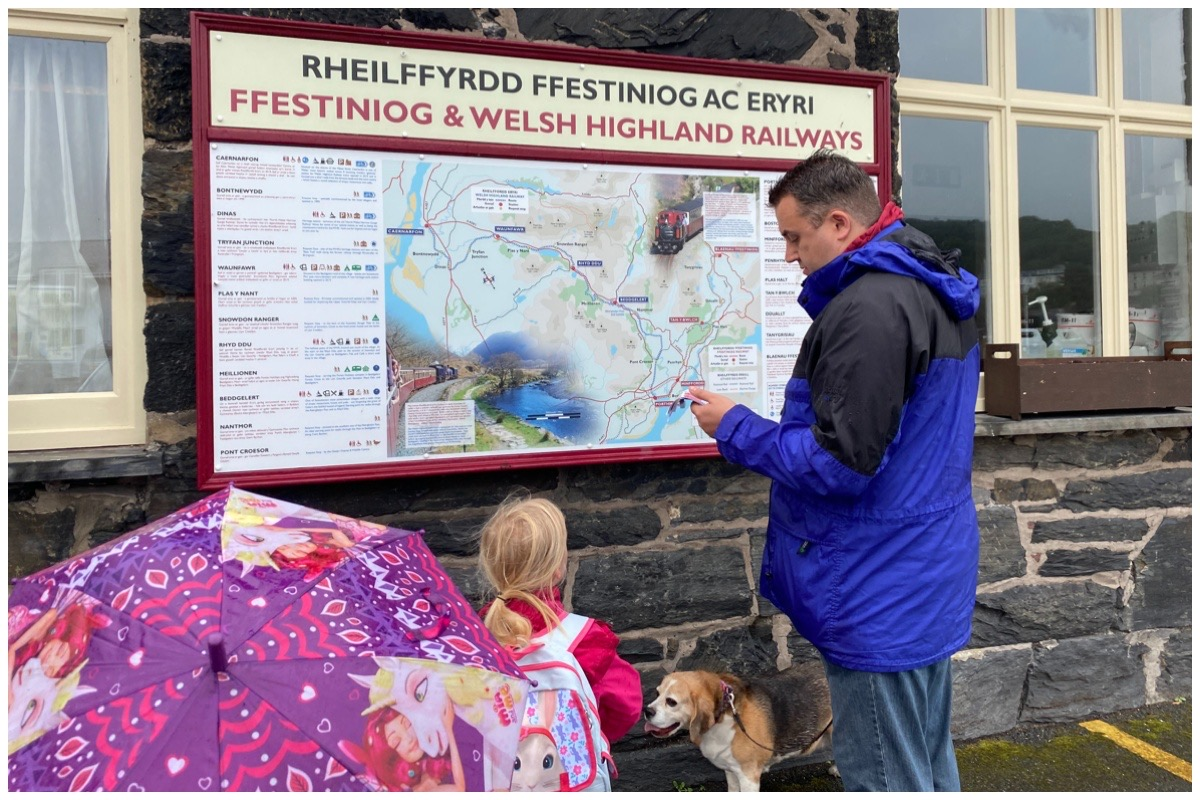 Husband and the littles looking at the map outside Ffestiniog Railway's Harbour Station