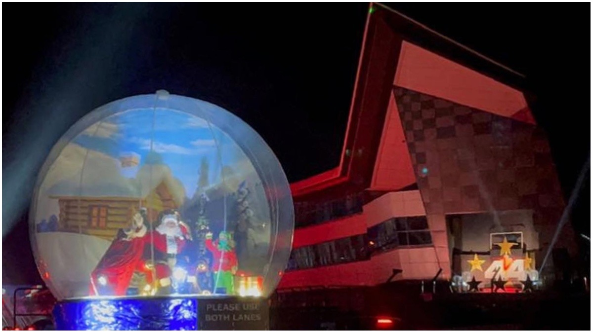 Santa in a snowglobe in front of the iconic Silverstone Wing