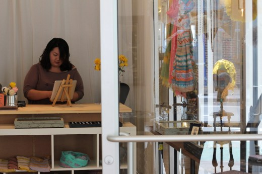 Jacqueline Yu in her specialty hat and jewelry shop, Oat