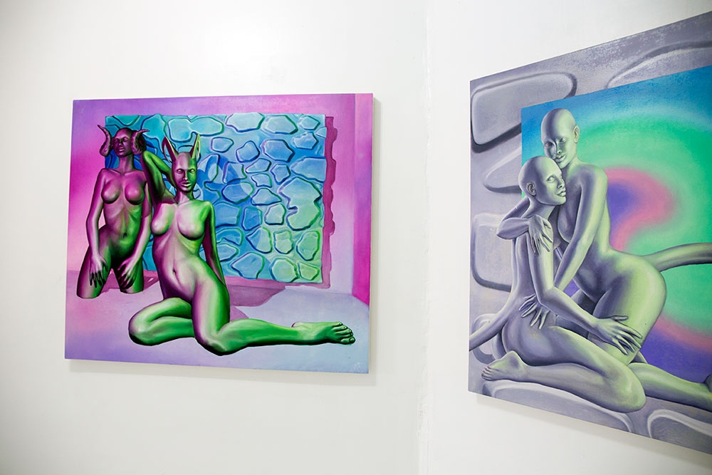 "Paintings by Emma Stern, left: ""Fauns (Horned Gals in Pink Room)"" right: ""The Body Politic (two fauns embracing)"" 2016 (Photo: Nicole Disser)"