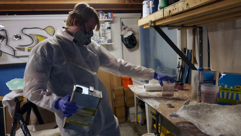 Burning the midnight oil, Murray mixes pink sparkles into toxic, liquid resin. (Photo: Karissa Gall)