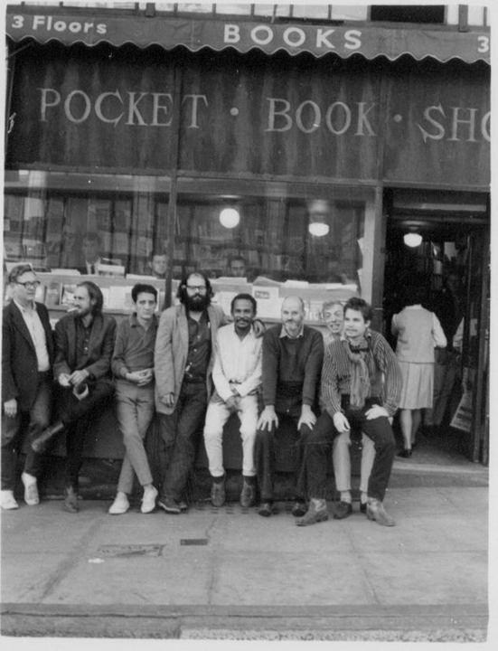 Philip Whalen, Bob Branaman, Gary Goodrow, Alan Ginsberg, Bob Kaufman, Lawrence Ferlinghetti, J. Richard White, Charlie Plymell (Photo courtesy of Ginsberg Collection/ Howl!)
