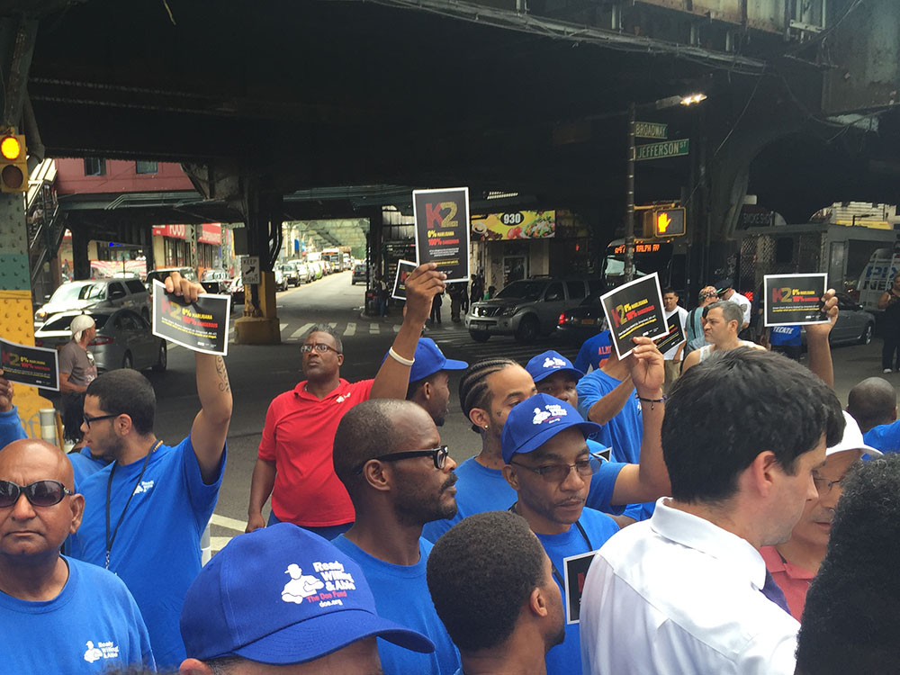 "The Doe Fund's ""men in blue"" at the Myrtle-Broadway press conference (Photo: Nicole Disser)"