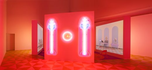 Alex Da Corte (b. 1980) with Jayson Musson (b. 1977). Easternsports, 2014. Four-channel video, color, sound; 152 min., with four screens, neon, carpet, vinyl composition tile, metal folding chairs, artificial oranges, orange scent, and diffusers. Score by Devonté Hynes. Collection of the artists; courtesy David Risley Gallery, Copenhagen, and Salon 94, New York. Installation view, Institute of Contemporary Art, University of Pennsylvania, 2014 © Alex Da Corte; image courtesy the artist and Institute of Contemporary Art, University of Pennsylvania