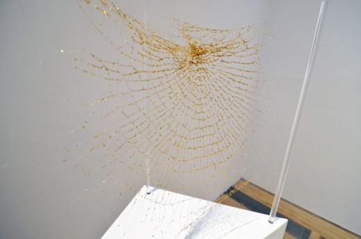 Michael Anthony Simon, Faux/Real, 2017, adhesive and glitter on Nephila clavata spider web (image courtesy of apexart)