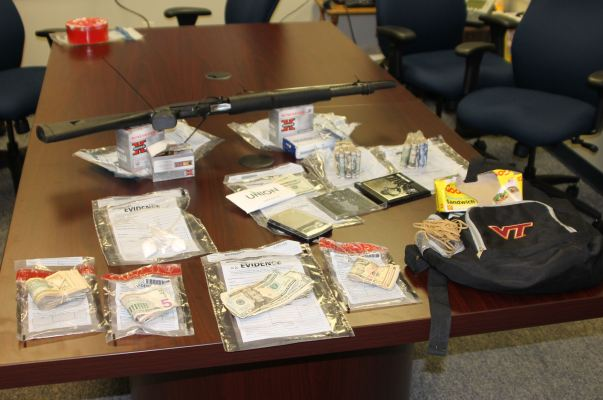 Cash $11,670.00, Powder Cocaine, Digital Scales, Shotgun.