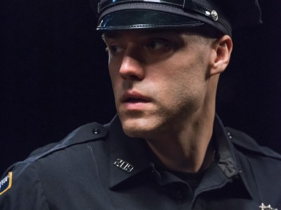 Bedlam Theatre actor in a scene: close up of a police officer in uniform
