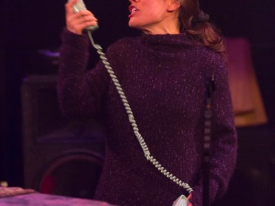 An actress in a scene yelling into a telephone receiver