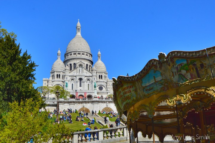 Sacre Couer in Montmartre with carousel in foreground