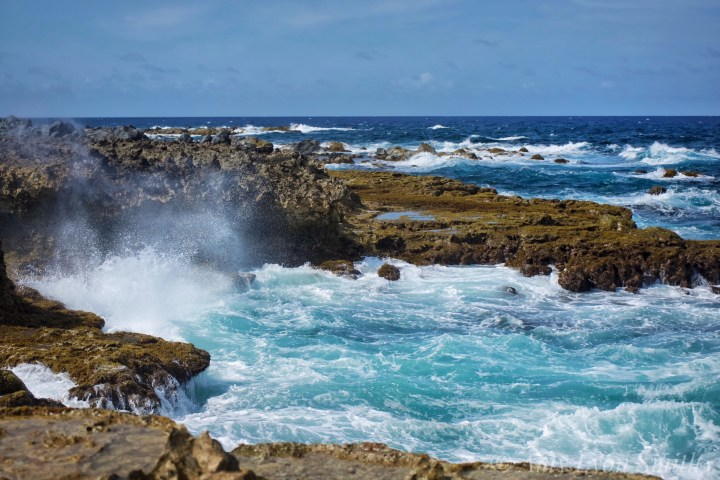 crashing waves at natural bridge in aruba