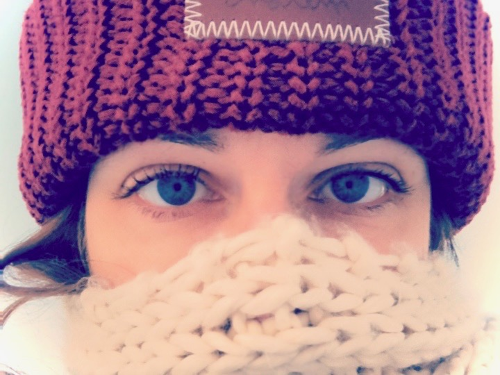 Amy Lyon Smith wearing a Love Your Melon beanie and wrapped in a scarf
