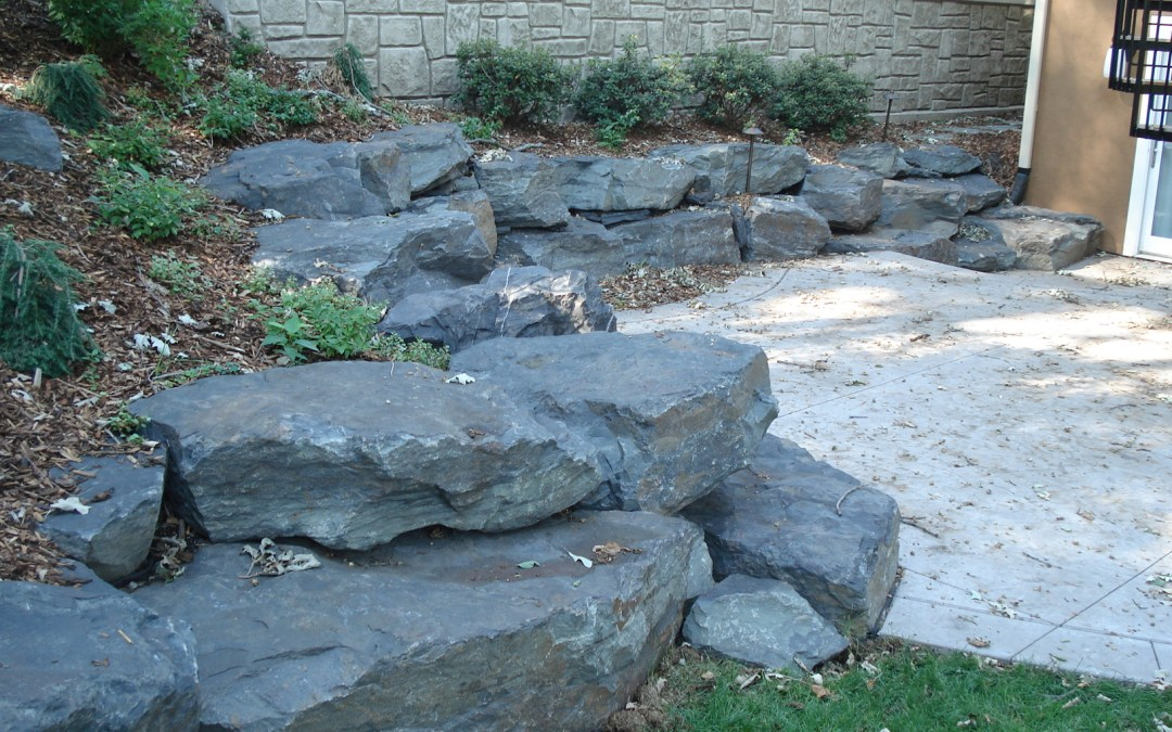 three rock solid landscape boulders