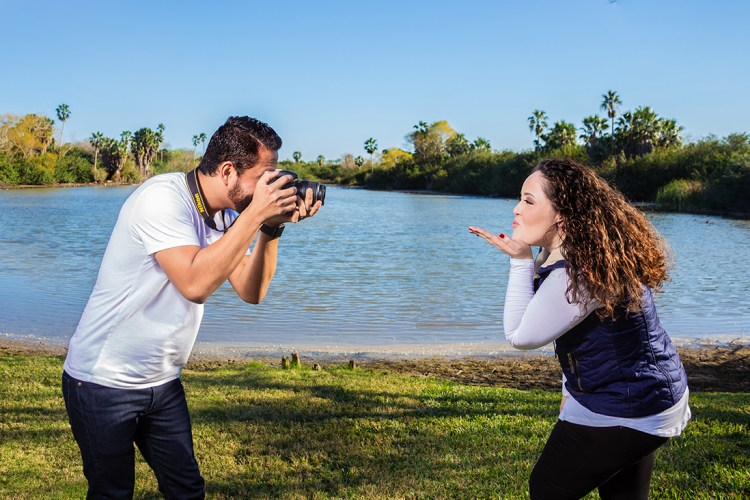 man taking photo of girl engagement photo shoot casa los ebanos