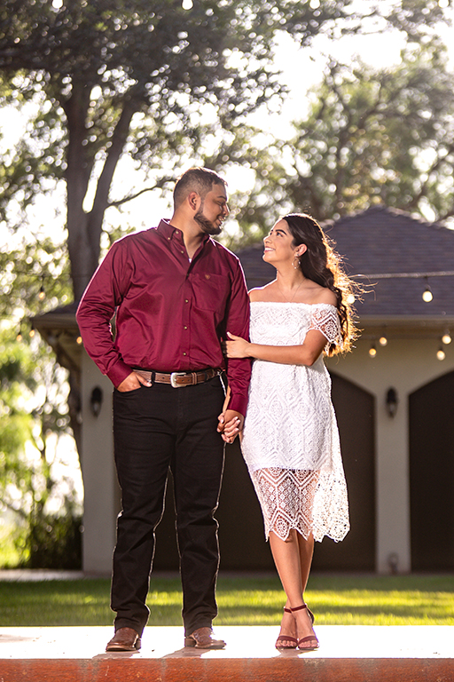 engaged couple smiling outdoor
