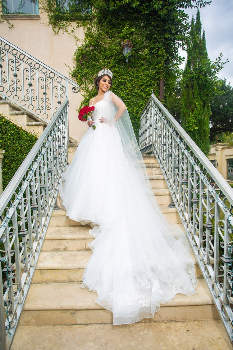 bride on staircase showing off dress rgv