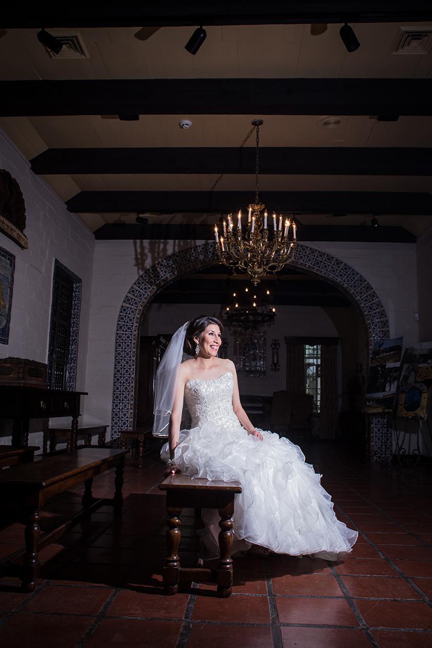 Bride posing at Quinta Mazatlan in McAllen, Texas for photos.