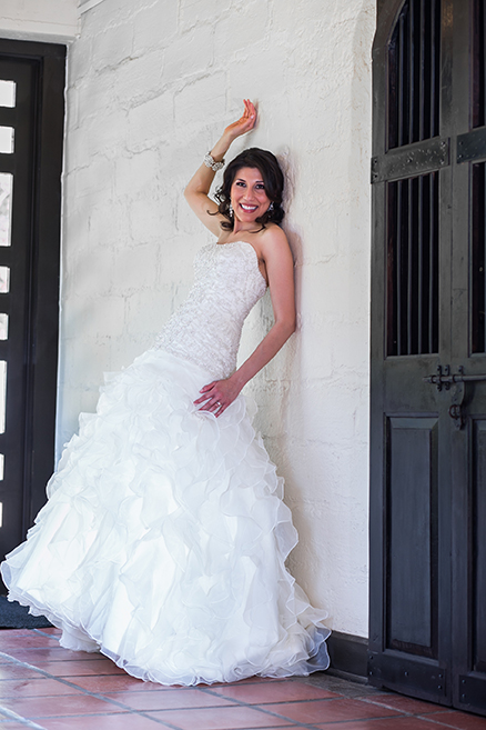 Bride leaning against a wall posing for a photo in McAllen, Texas.