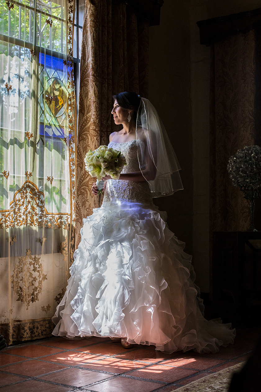 Bride with stained glass reflections at Quinta Mazatlan in McAllen, Texas.