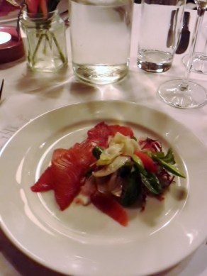 balsamic and beetroot cured salmon with blood orange, fennel and winter leaves