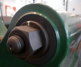 A hand sized bolt on the main Kirkaldy Machine