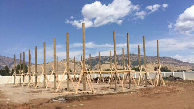 Pole Barn Construction - Standing the Poles - Beehive Buildings