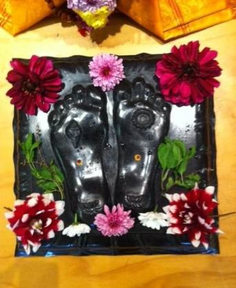 top view of balck granite padukas with flowers